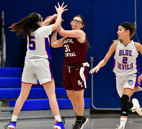 12/13/2018 Mike Orazzi | Staff Plainville High School's Jaida Vasquez (5) and Bristol Central's Lia Randam (31) during Thursday night's basketball game at PHS.