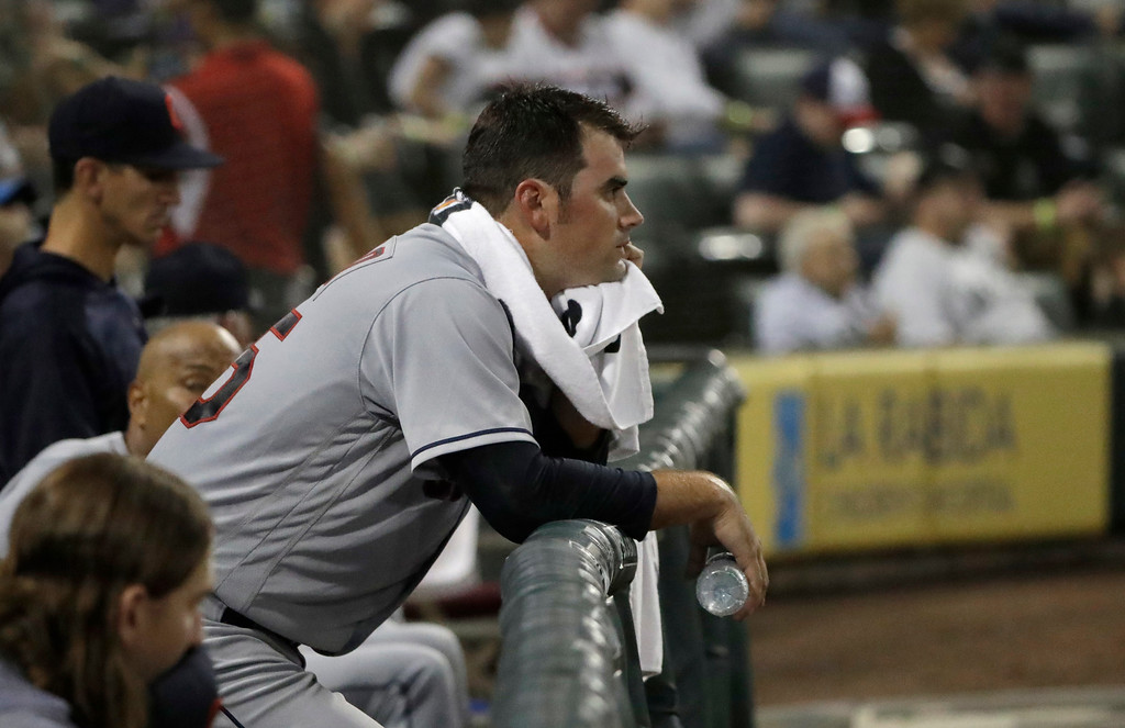 . Cleveland Indians starting pitcher Adam Plutko rests on the dugout rail after being pulled in the fifth inning of a baseball game against the Chicago White Sox Tuesday, June 12, 2018, in Chicago. (AP Photo/Charles Rex Arbogast)