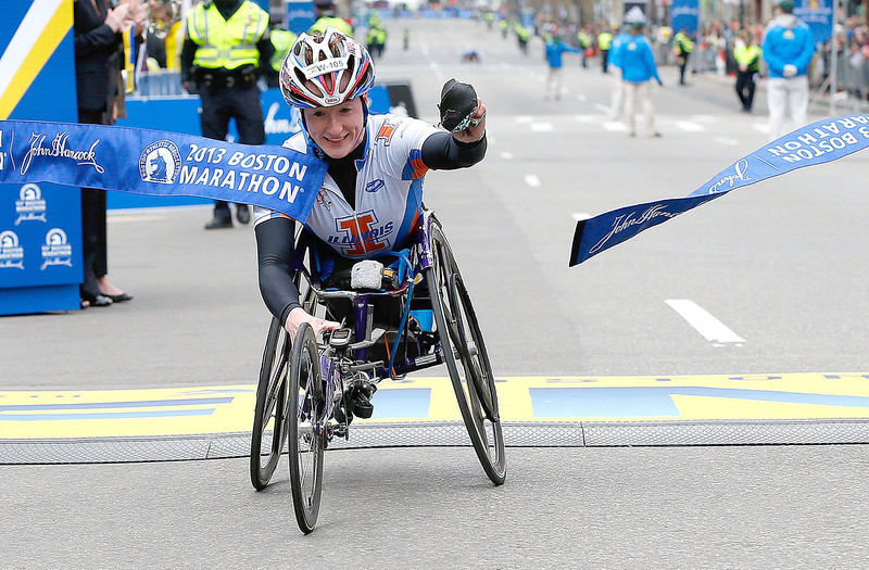 . Tatyana McFadden of the United States reacts as she crosses the finish line to win the women\'s wheelchair division of the 117th Boston Marathon on April 15, 2013 in Boston, Massachusetts.  (Photo by Jim Rogash/Getty Images)