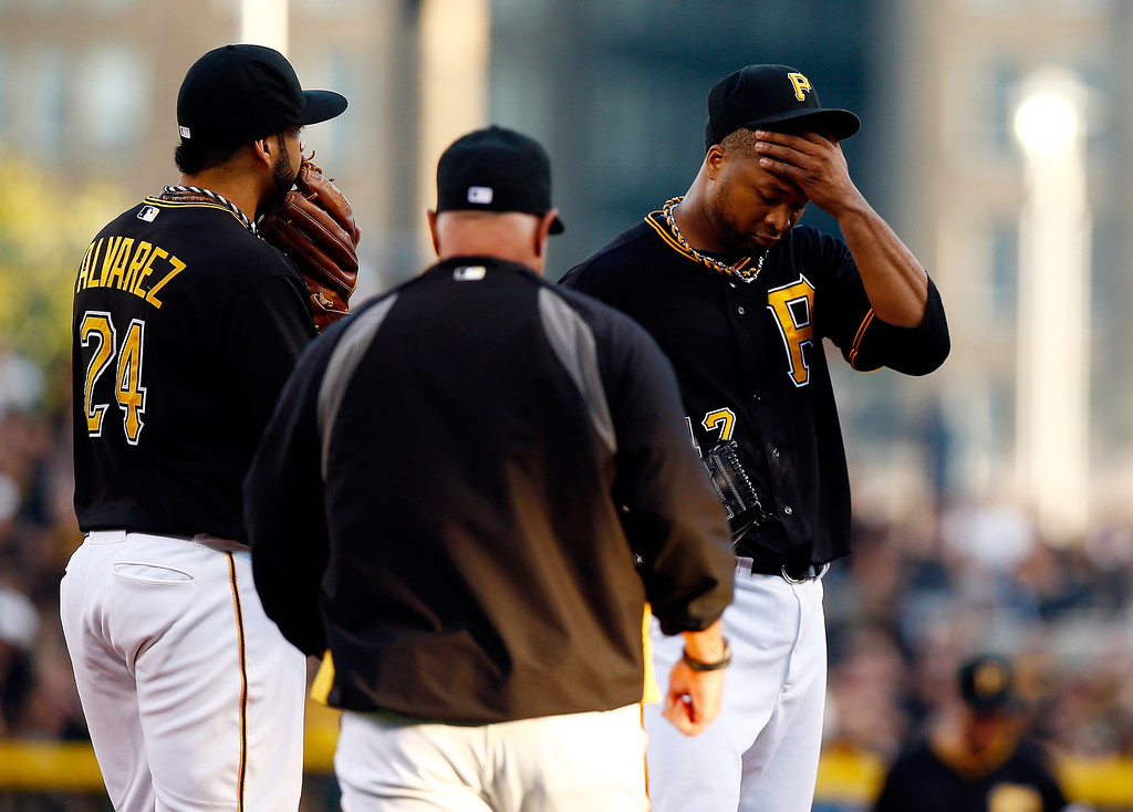 . Pitching coach Ray Searage #54 meets with Francisco Liriano #47 of the Pittsburgh Pirates on the mound in the fifth inning during Game Three of the National League Division Series against the St. Louis Cardinals at PNC Park on October 6, 2013 in Pittsburgh, Pennsylvania.  (Photo by Jared Wickerham/Getty Images)