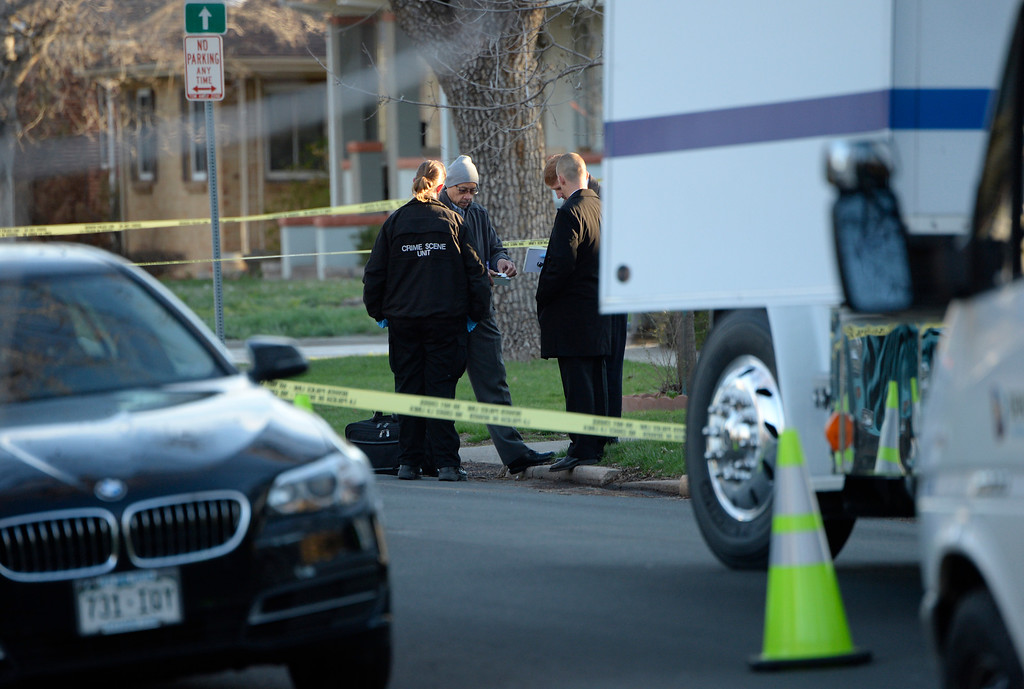 . Denver police investigate a homicide at a home in the 2100 block of South Saint Paul Street in Denver, Tuesday, April 15, 2014.  (Photo by RJ Sangosti/The Denver Post)