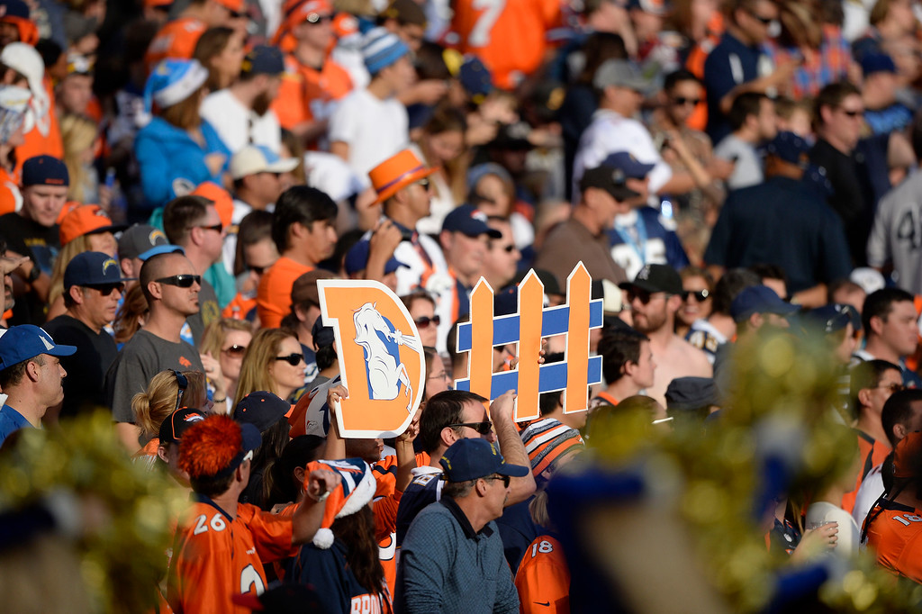 . SAN DIEGO, CA - DECEMBER 14: Denver Broncos fans hold up their signs against the San Diego Chargers December 14, 2014 at Qualcomm Stadium (Photo By John Leyba/The Denver Post)