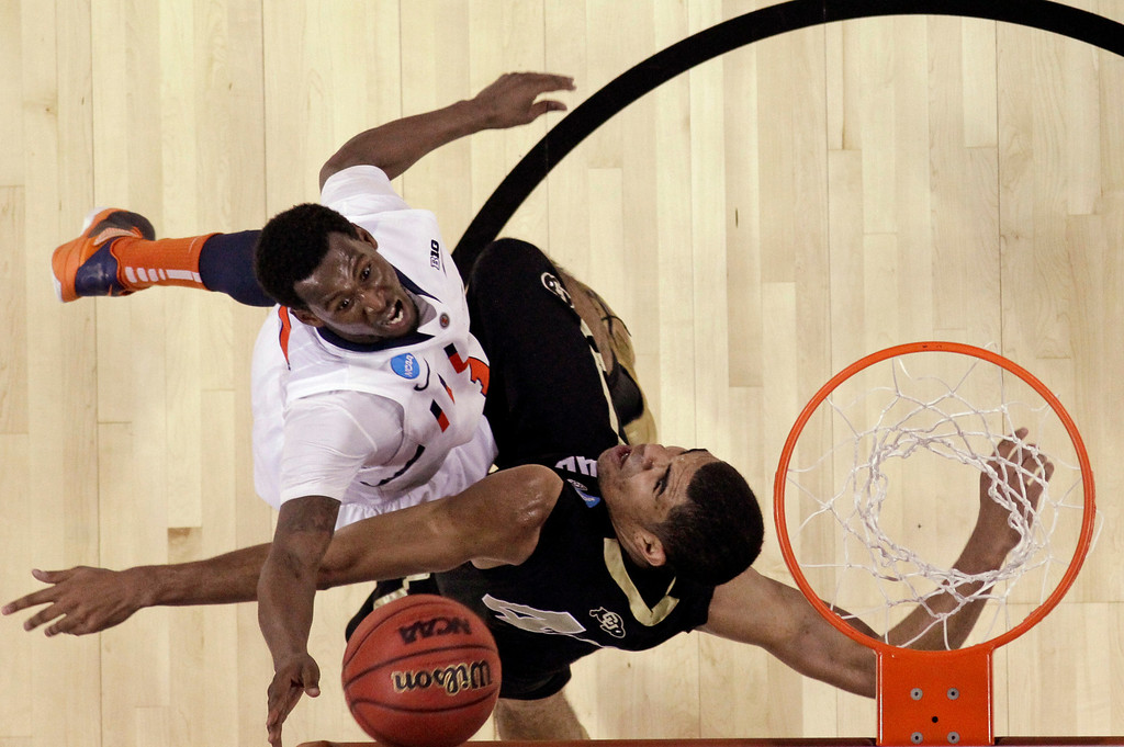 . Illinois\' D.J. Richardson, left, is fouled by Colorado\'s Josh Scott (40) during the second half of a second-round game of the NCAA men\'s college basketball tournament Friday, March 22, 2013, in Austin, Texas. Illinois defeated Colorado 57-49. (AP Photo/David J. Phillip)