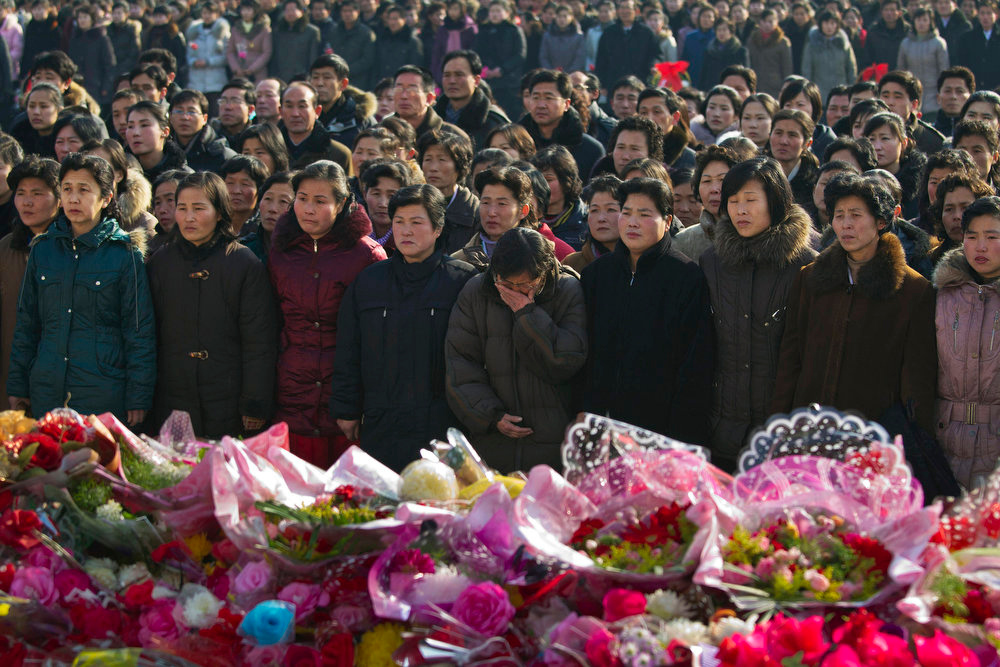 . A North Korean woman cries as she and others pay their respects beneath a large portrait of the late leader Kim Jong Il to commemorate his death and what would have been his 70th birthday on Thursday, Feb. 16, 2012.  (AP Photo/David Guttenfelder)