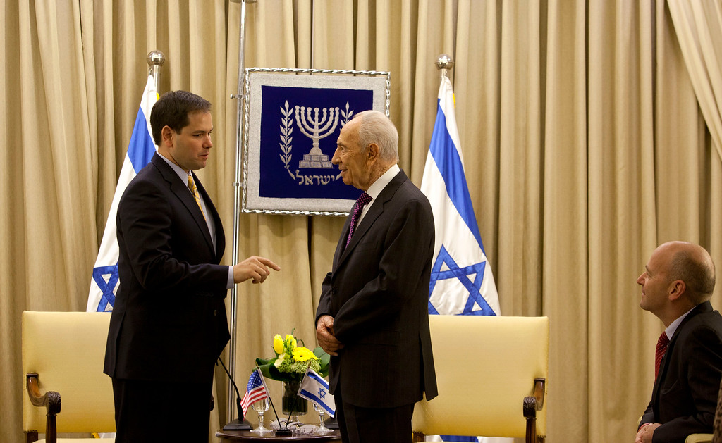 . Israel\'s President Shimon Peres, center right, speaks with US Sen. Marco Rubio, R-Fla. left, during their meeting in the President\'s residence in Jerusalem, Wednesday, Feb. 20, 2013.  (AP Photo/Sebastian Scheiner)