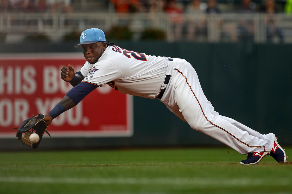 . Minnesota Twins third baseman Miguel Sano dives for but misses a double hit by the Cleveland Indians\' Jose Ramirez in the first inning of baseball game two of a doubleheader Saturday, June 17, 2017, in Minneapolis. (AP Photo/Bruce Kluckhohn)