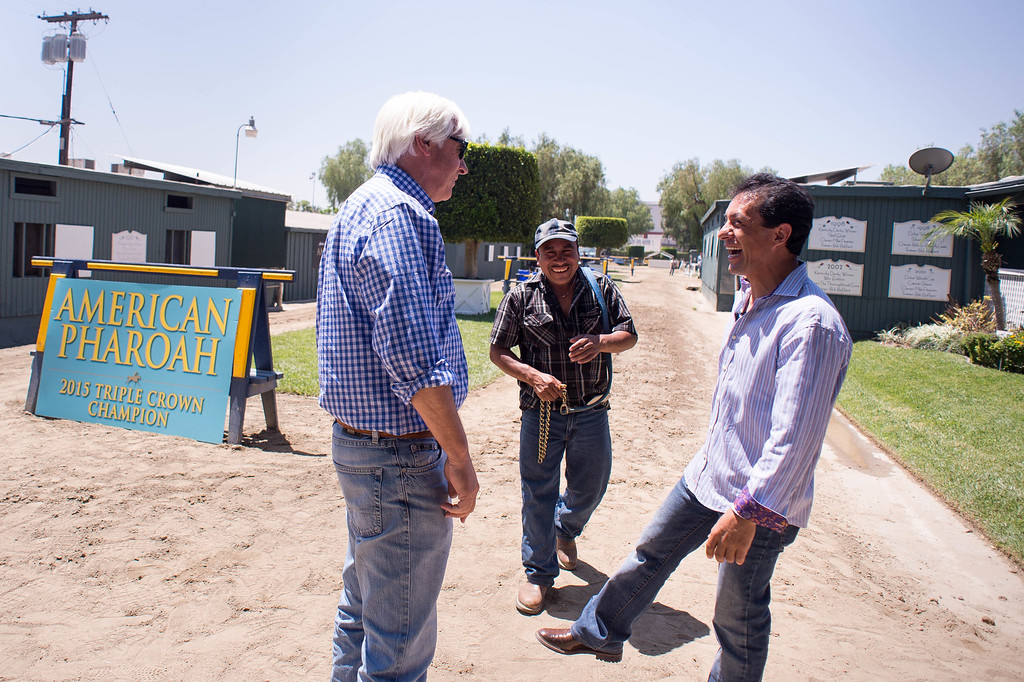 . Trainer Bob Baffert and Jockey Victor Espinoza wait for Triple Crown-winner American Pharoah to return home to Baffert\'s barn at Santa Anita Thursday, June 18, 2015. American Pharoah and Espinoza broke a 37-year Triple Crown drought by winning the Kentucky Derby, Preakness and Belmont Stakes. (Photo by Sarah Reingewirtz/Pasadena Star-News)