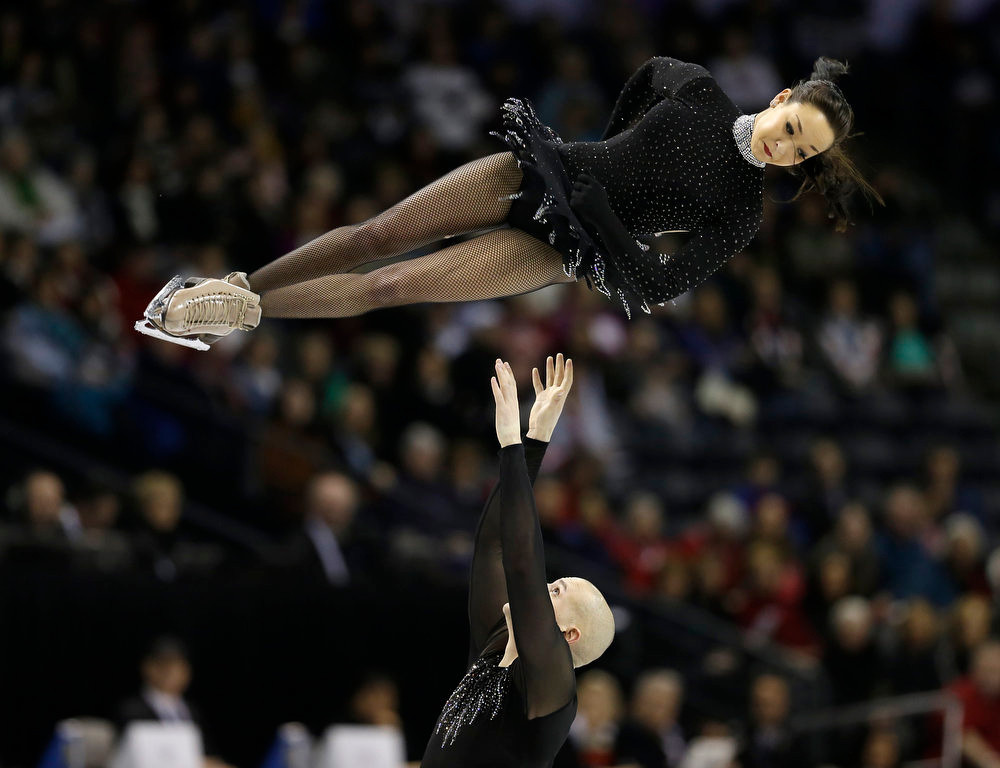 . Mari Vartmann and Aaron Van Cleave, of Germany, perform during the pairs short program at the World Figure Skating Championships Wednesday, March 13, 2013, in London, Ontario. (AP Photo/Darron Cummings)
