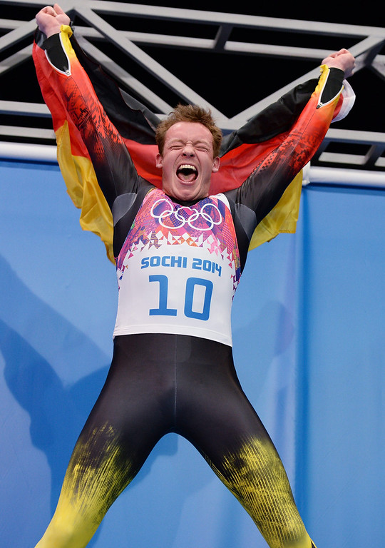. Felix Loch of Germany celebrates at the end of his fourth run winning gold in the men\'s singles Luge at the Sanki Sliding Center at the Sochi 2014 Olympic Games, Krasnaya Polyana, Russia, 09 February 2014.  EPA/VASSIL DONEV