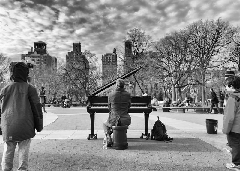 A piano player in Washington Square Park, New York, NY.