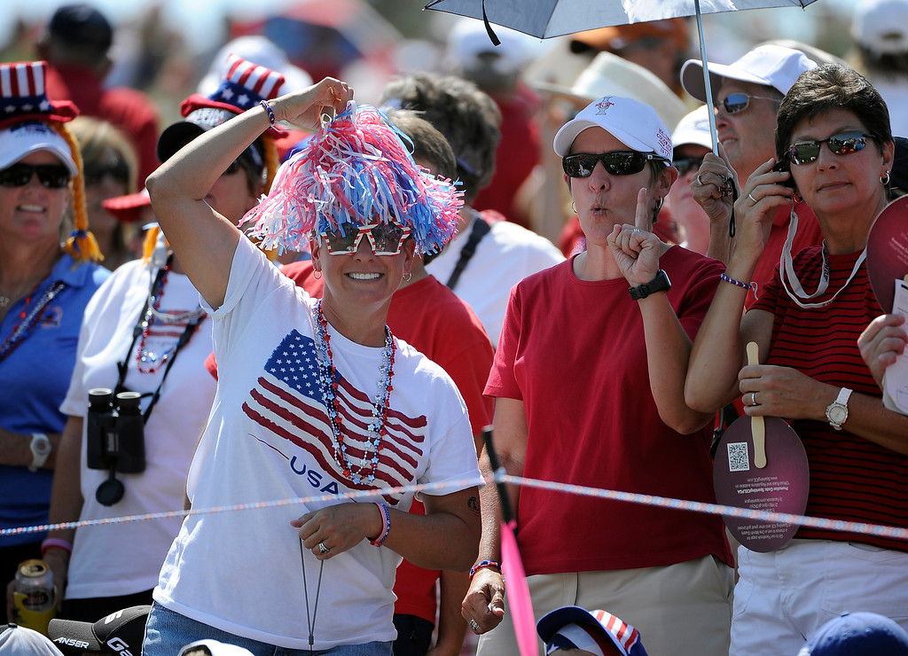 . PARKER, CO - Aug.17: Team USA fas cheer on their players on the 16th green. The 2013 Solheim Cup takes place at the Colorado Golf Club with the USA taking on Europe in the Saturday morning Foursomes Match. (Photo By Kathryn Scott Osler/The Denver Post)