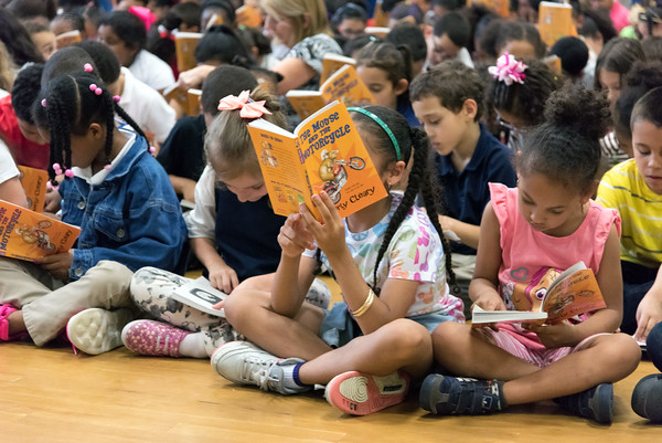 06/01/18 Wesley Bunnell | Staff Lincoln Elementary School held a One School, One Book event on Friday afternoon giving every student the same book to bring home to be read with their parents. The books were wrapped with the title kept a secret until being passed out.