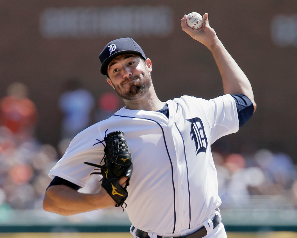 . Detroit Tigers pitcher Robbie Ray delivers against the Seattle Mariners during the first inning of a baseball game on Sunday, Aug. 17, 2014, in Detroit. (AP Photo/Duane Burleson)