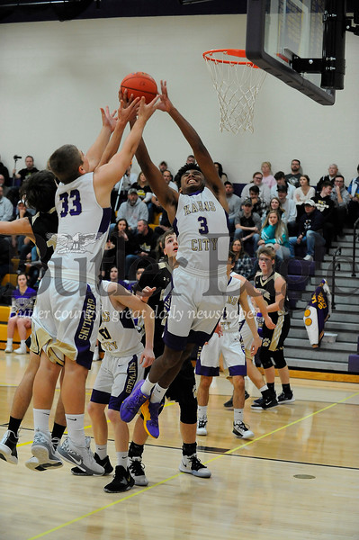 Karns City #33 Daunte Young and #3 Micah Rupp goes up for the rebound during a game verses Keystone at Karns City Gym on Friday December 13, 2019 (Jason Swanson photo)