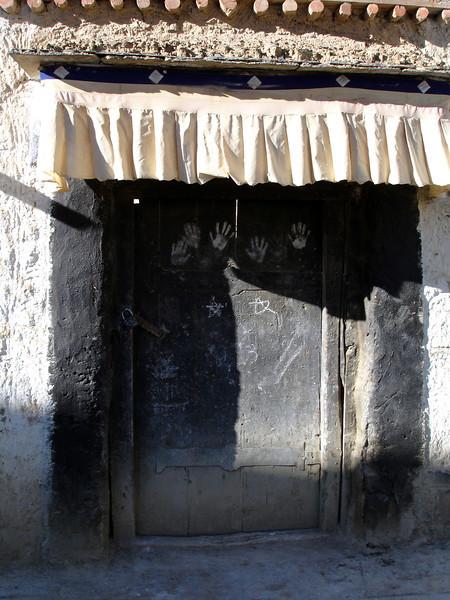 black door with hand prints in Sera Monastery