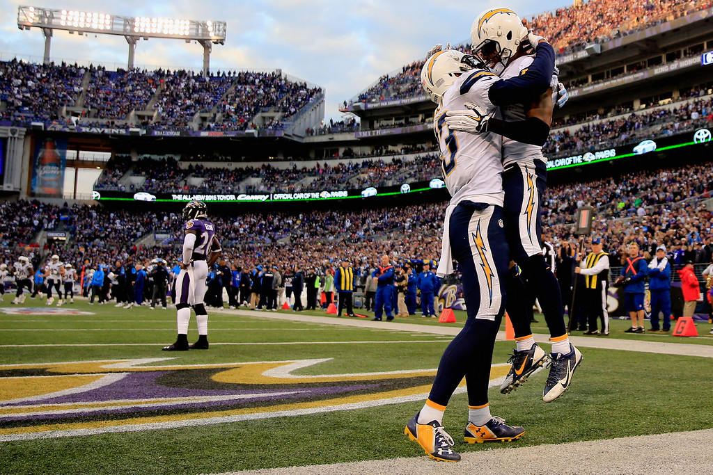 . BALTIMORE, MD - NOVEMBER 30: Wide receiver Eddie Royal #11 of the San Diego Chargers celebrates with wide receiver Keenan Allen #13 of the San Diego Chargers after catching the game winning touchdown in the fourth quarter of a game against the Baltimore Ravens at M&T Bank Stadium on November 30, 2014 in Baltimore, Maryland.  (Photo by Rob Carr/Getty Images)