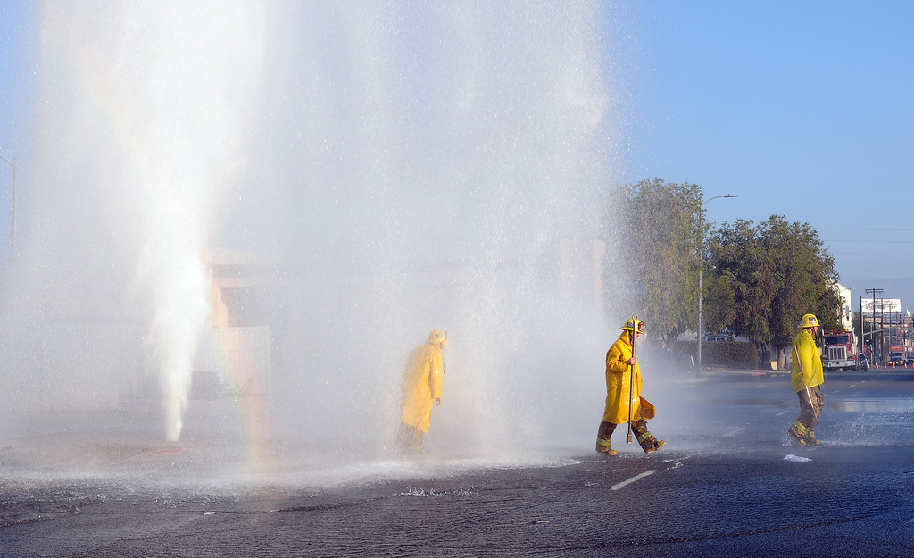 . A vehicle sheared off a hydrant today in Woodland Hills and ended up in a nearby wash, authorities said. The crash in the 22000 block of Vanowen Street was reported about 6:30 a.m. on Monday, February 24, said Erik Scott of the Los Angeles Fire Department. The driver was uninjured, Scott said. Crews were sent to shut off the flow of water, which spouted an estimated 60 feet into the air after the crash.  (Photo by Dean Musgrove/Los Angeles Daily News)