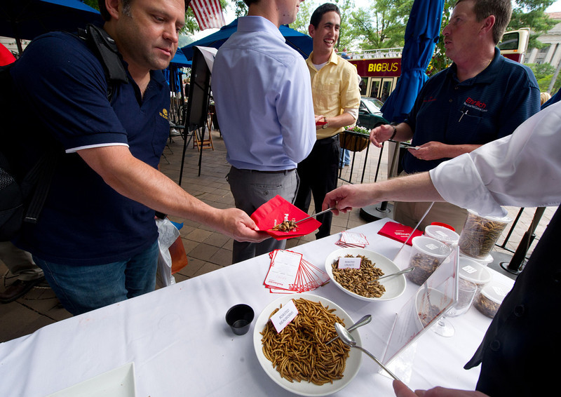 . A patron takes a helping of roasted mealworms and roasted crickets on June 4, 2014 during a global Pestaurant event sponsored by Ehrlich Pest Control, held at the Occidental Restaurant in Washington, DC. For one day only, pop-up Pestaurants will appear in cities across the globe to offer sweet and savory edible insects, grasshopper burgers and much more. Ehrlich Pest Control will be donating $5 USD to DC Central Kitchen for every person who eats something at the event.  (KAREN BLEIER/AFP/Getty Images)