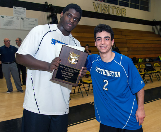 05/24/18 Wesley Bunnell | Staff Southington volleyball defeated Newington at East Hartford High School on Thursday night to capture the 2018 CCC Championship. Jonathan Clark (22) and Niko Sophroniou (2) accept the championship plaque.