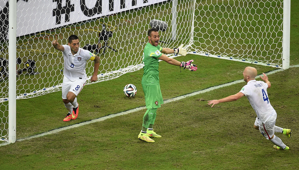 . US forward Clint Dempsey (L) celebrates after scoring during a Group G football match between USA and Portugal at the Amazonia Arena in Manaus during the 2014 FIFA World Cup on June 22, 2014.    FABRICE COFFRINI/AFP/Getty Images