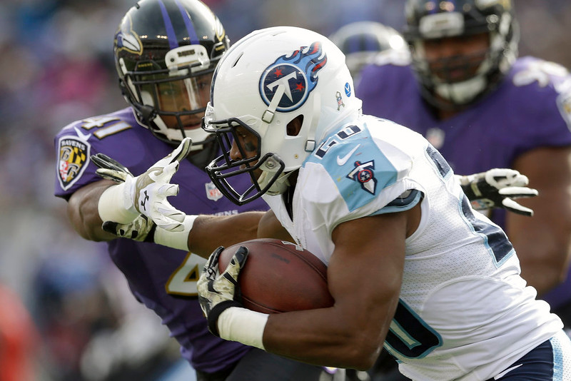 . Baltimore Ravens defensive back Anthony Levine (41) reaches for Tennessee Titans running back Bishop Sankey (20) during the first half of an NFL football game in Baltimore, Sunday, Nov. 9, 2014. (AP Photo/Patrick Semansky)