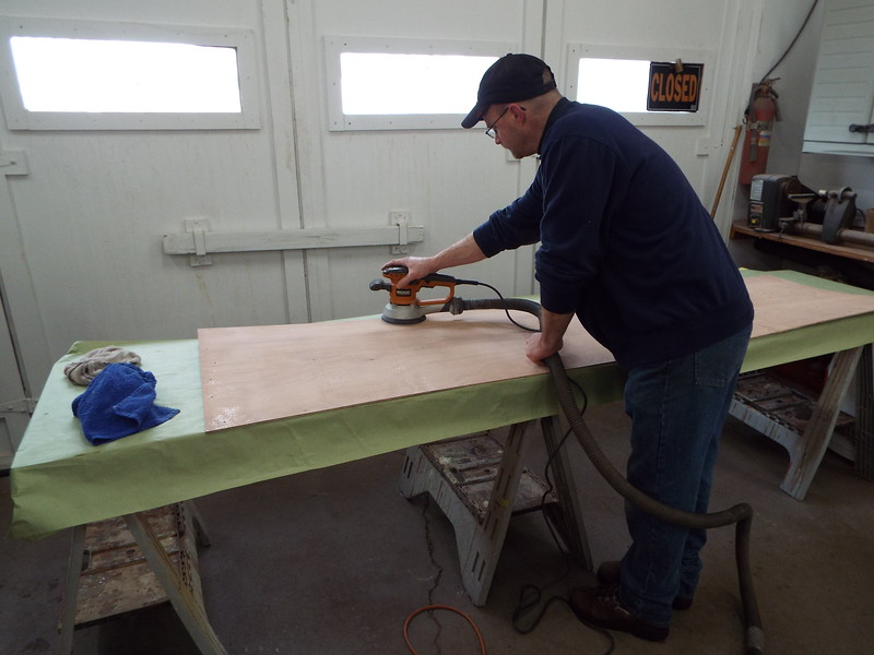 Sanding the inside of the plywood skin before we install it.