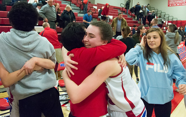 03/01/19 Wesley Bunnell | Staff Berlin defeated Ansonia 54-52 on Friday night. Ashley Wenzel (10) who hugs Head Coach Sheila King