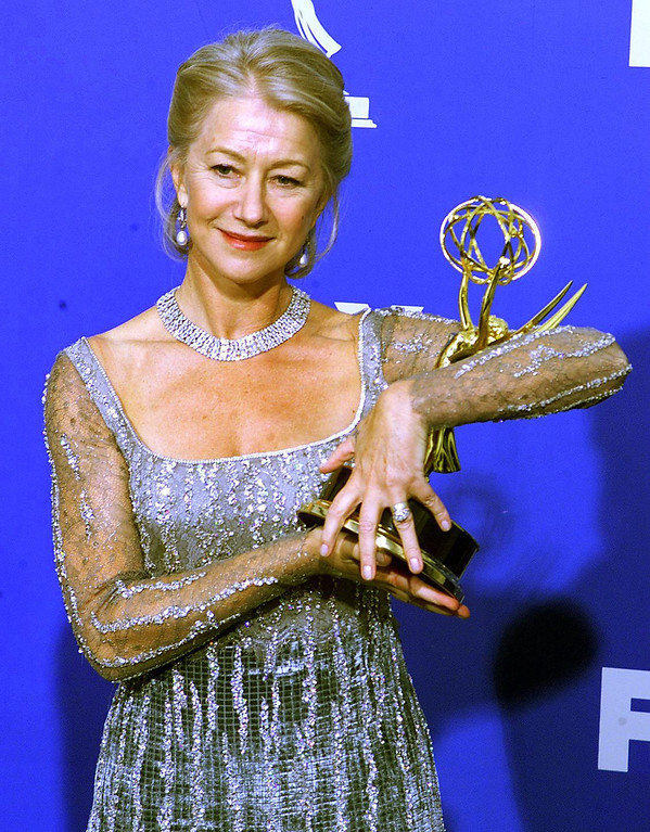 """. British actress Helen Mirren cradles the Emmy Award she won for Outstanding Lead Actress in a Miniseries or a Movie for her role in \""""The Passion of Ayn Rand\"""", at the Shrine Auditorium in Los Angeles, CA, 12 September, 1999.   Scott Nelson/AFP/Getty Images"""
