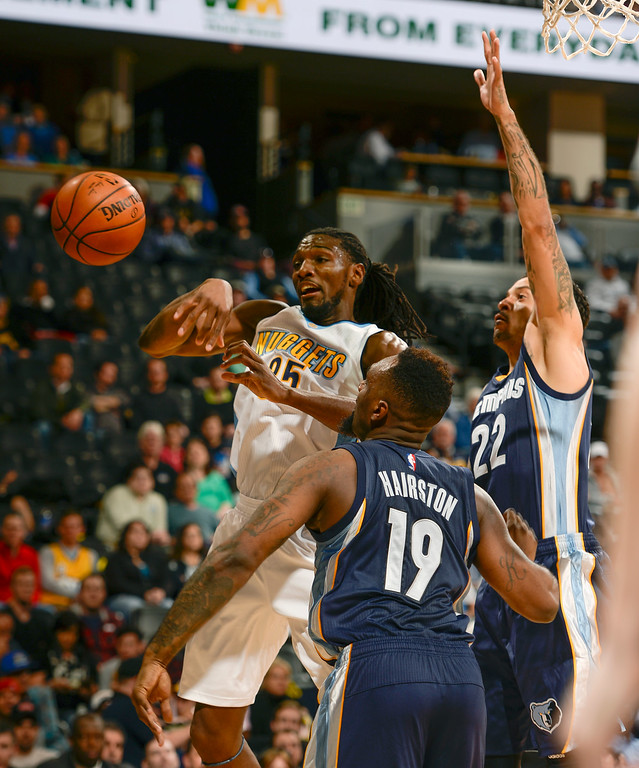 . DENVER, CO - FEBRUARY 29: Memphis Grizzlies forward P.J. Hairston (19) swats the ball away from Denver Nuggets forward Kenneth Faried (35) February 29, 2016 at Pepsi Center. (Photo By John Leyba/The Denver Post)