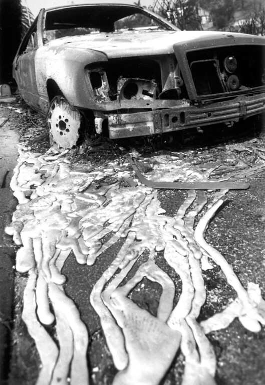 . The hulk of a car that fire destroyed sits on Rambla Orienta in Malibu.  (11/3/93)   Los Angeles Daily News file photo