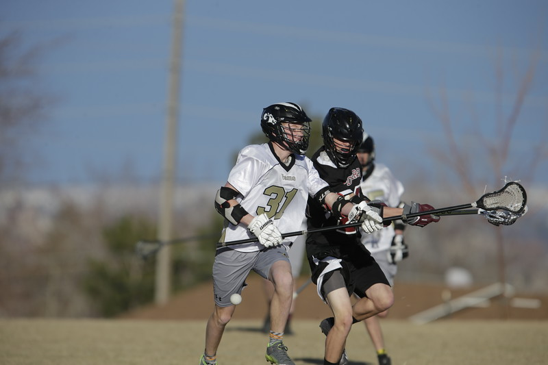 JPM0070-JPM0070-Jonathan first HS lacrosse game March 9th.jpg