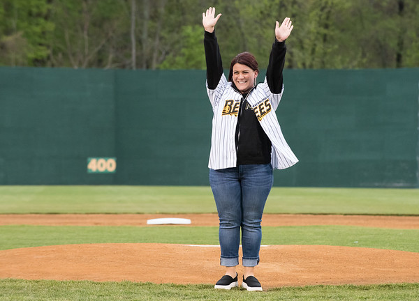 05/03/19 Wesley Bunnell | Staff The New Britain Bees home opener vs the Somerset Patriots on Friday night at New Britain Stadium. New Britain Mayor Erin Stewart raises her hands in the air after throwing out the ceremonial first pitch.