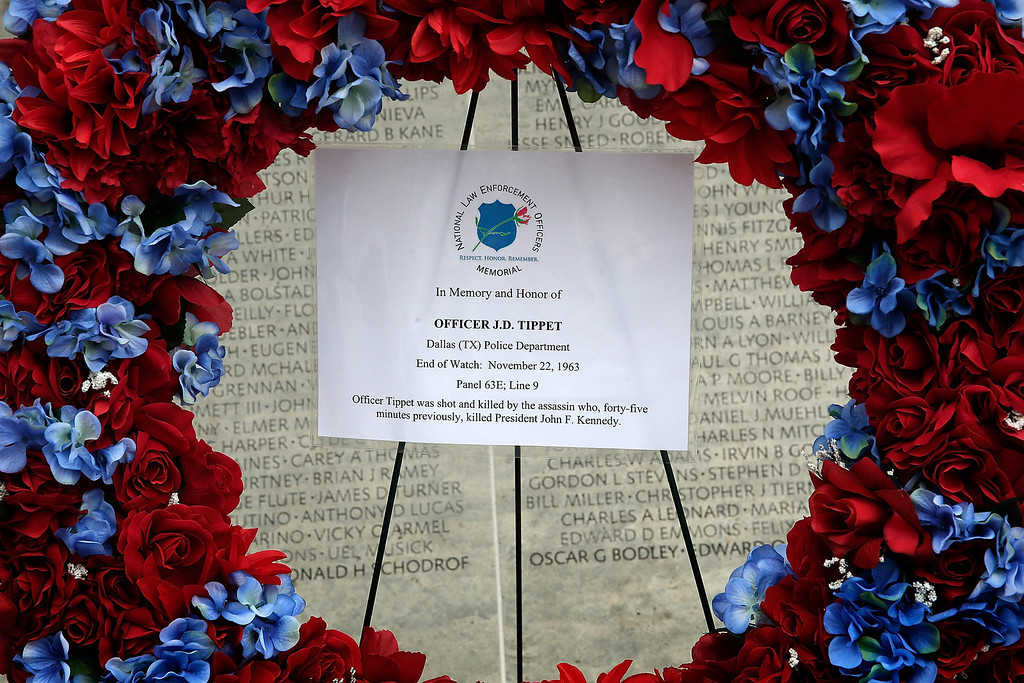 . A wreath honoring Dallas Police Officer J.D. Tippit is placed at the National Law Enforcement Officers Memorial November 22, 2013 in Washington, DC. Tippit was shot and killed by Lee Harvey Oswald when the police officer stopped to question Oswald following the assassination of U.S. President John F. Kennedy 50 years ago today.