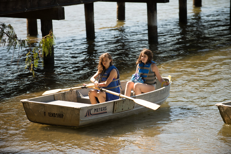 r rowing with her friend.