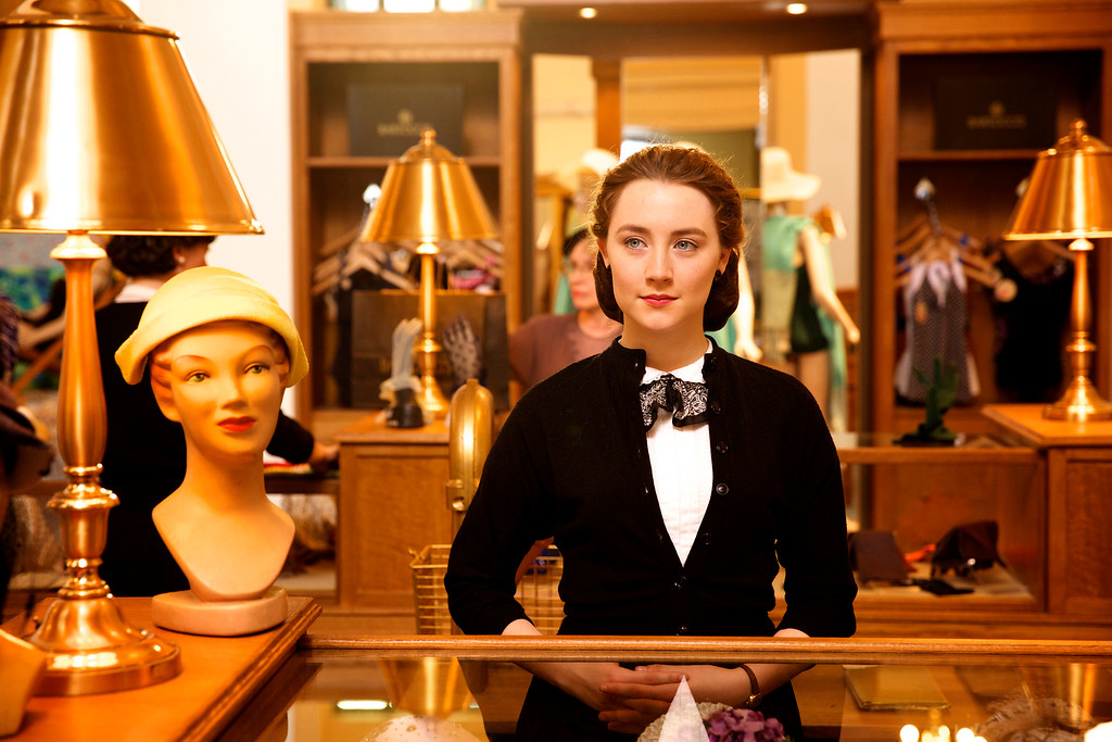 """. This photo provided by Fox Searchlight shows Saoirse Ronan as Eilis in a scene from the film, \""""Brooklyn.\"""" Ronan was nominated for an Oscar for best actress on Thursday, Jan. 14, 2016, for her role in the film. The 88th annual Academy Awards will take place on Sunday, Feb. 28,, at the Dolby Theatre in Los Angeles. (Kerry Brown/Fox Searchlight via AP)"""
