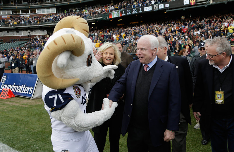. U.S. Senator John McCain of Arizona shakes hands with Bill the Goal, the Navy Midshipmen mascot, before the Kraft Fight Hunger Bowl between the Arizona State Sun Devils and the Navy Midshipmen at AT&T Park on December 29, 2012 in San Francisco, California.  (Photo by Ezra Shaw/Getty Images)