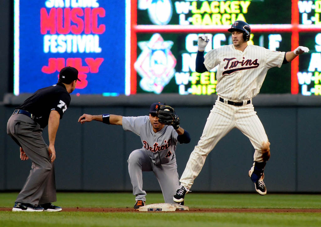 . The Twins\' Trevor Plouffe is out at second after trying to stretch a single into a double in the seventh inning. Detroit\'s Omar Infante made the tag. (Pioneer Press: Sherri LaRose-Chiglo)