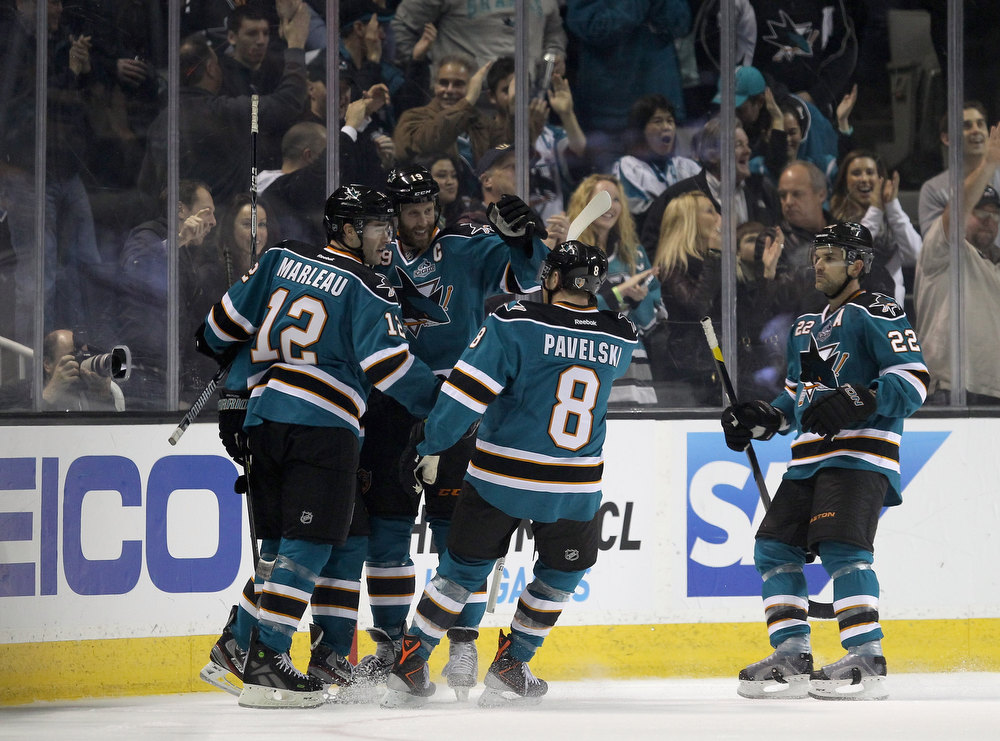 . SAN JOSE, CA - JANUARY 24:  Logan Couture #39 of the San Jose Sharks is surrounded by his teammates after he scored a powerplay goal in the first period of their game against the Phoenix Coyotes at HP Pavilion on January 24, 2013 in San Jose, California.  (Photo by Ezra Shaw/Getty Images)