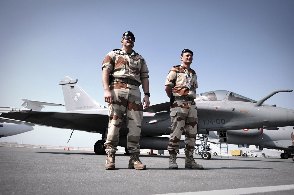 . Members of the French Air show team (MIRAG 2000) stand next to their aircrafts during the opening of the Bahrain International Airshow 2014, in Sakhir, south of the capital Manama, on January 16, 2014. (MOHAMMED AL-SHAIKH/AFP/Getty Images)