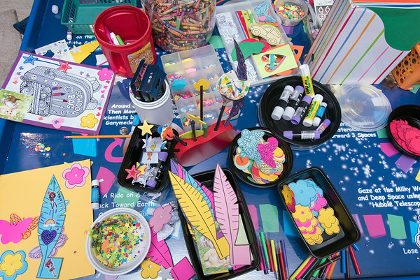 08/23/18 Wesley Bunnell | Staff The New Britain Youth Museum held a back to school party featuring activities, prizes and New Britain Bees mascot Sting on Thursday afternoon. Children decorate school folders with stickers and markers at a decorating table.