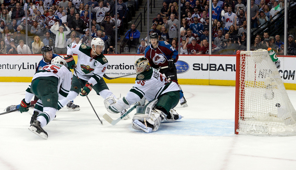 . DENVER, CO - APRIL 26: Colorado Avalanche right wing P.A. Parenteau (15) fires the puck past Minnesota Wild goalie Darcy Kuemper (35) to tie the game 3 to 3 during the third period of action. The Colorado Avalanche hosted the Minnesota Wild in the fifth round of the Stanley Cup Playoffs at the Pepsi Center in Denver, Colorado on Saturday, April 26, 2014. (Photo by John Leyba/The Denver Post)