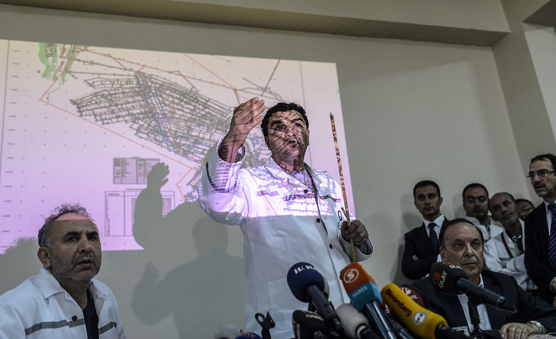 . Akin Celik, the operating manager of the Soma Coal Mining Company, (C) speaks as a map of the mine where an explosion killed at least 284 workers two days ago is projected on wall, during a press conference on May 16, 2014, in the western town of Soma in Manisa. The operator of the mine denied charges of negligence, as the government warning that the toll from the blast would likely top 300, Turkey\'s prime minister faced fresh criticism after video emerged of him apparently shouting an anti-Israel slur at angry protesters during a visit the day after to the disaster site. (BULENT KILIC/AFP/Getty Images)