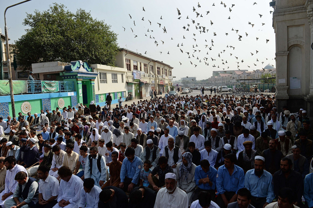 . Afghan men pray to celebrate Eid al-Fitr and the end of the fasting month of Ramadan at the Shah-e Do Shamshira mosque in Kabul on August 8, 2013. Muslims around the world are celebrating Eid al-Fitr this week, marking the end of the holy month of Ramadan during which followers are required to abstain from food, drink and sex from dawn to dusk. SHAH MARAI/AFP/Getty Images