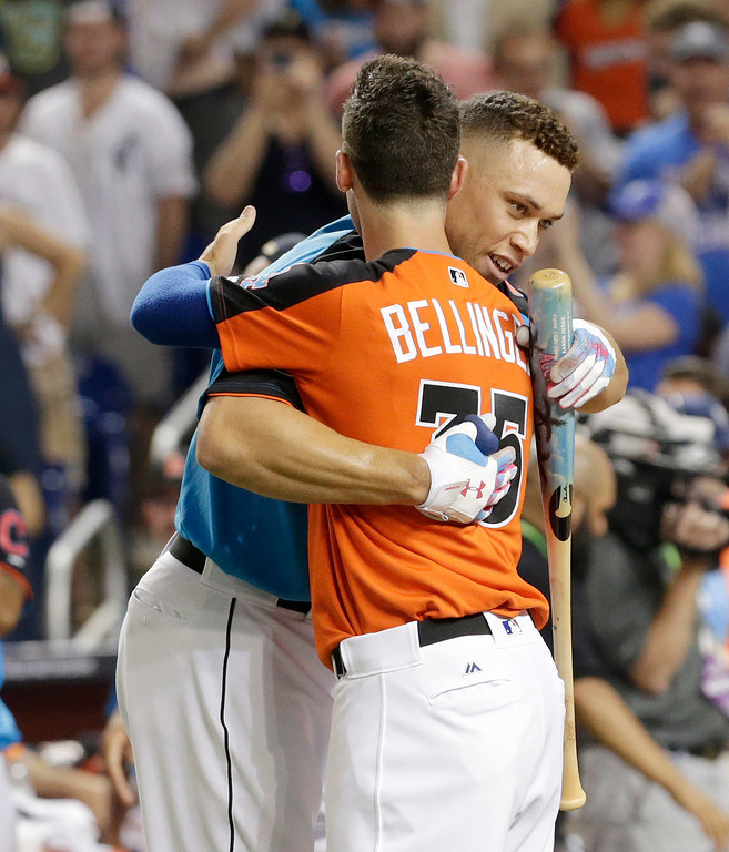 . New York Yankees\' Aaron Judge is hugged by Los Angeles Dodgers\' Cody Bellinger (35) during the MLB baseball All-Star Home Run Derby, Monday, July 10, 2017, in Miami. (AP Photo/Lynne Sladky)