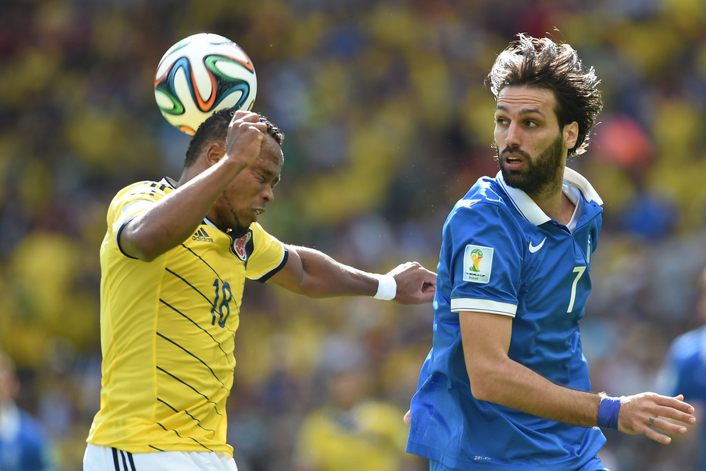 . Greece\'s forward Georgios Samaras (R) in action against Colombia\'s defender Camilo Zuniga during a group C football match between Colombia and Greece at the Mineirao Arena in Belo Horizonte during the 2014 FIFA World Cup on June 14, 2014.    AFP PHOTO / PEDRO UGARTE