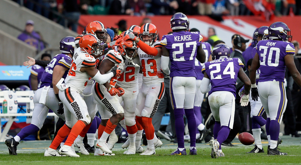 . Cleveland Browns running back Matthew Dayes (27) is congratulated by his teammates after rushing during the second half of an NFL football game against Minnesota Vikings at Twickenham Stadium in London, Sunday Oct. 29, 2017. (AP Photo/Tim Ireland)