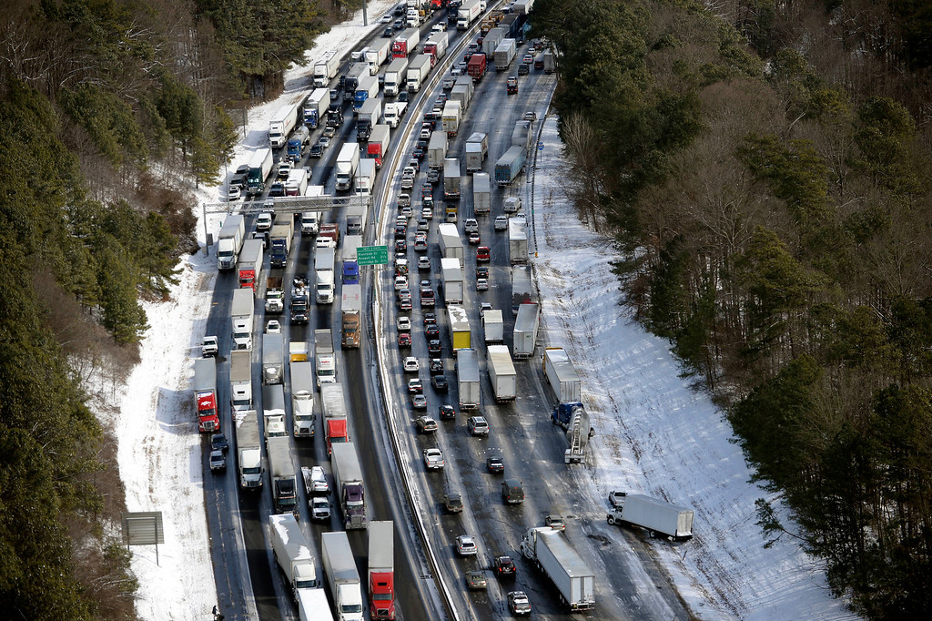 . In this aerial photo, traffic is snarled along the I-285 perimeter north of the metro area after a winter snow storm, Wednesday, Jan. 29, 2014, in Atlanta.   (AP Photo/David Tulis)