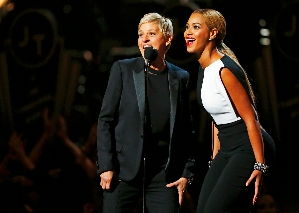 . Beyonce and Ellen DeGeneres (R) introduce Justin Timberlake at the 55th annual Grammy Awards in Los Angeles, California, February 10, 2013.  REUTERS/Mike Blake