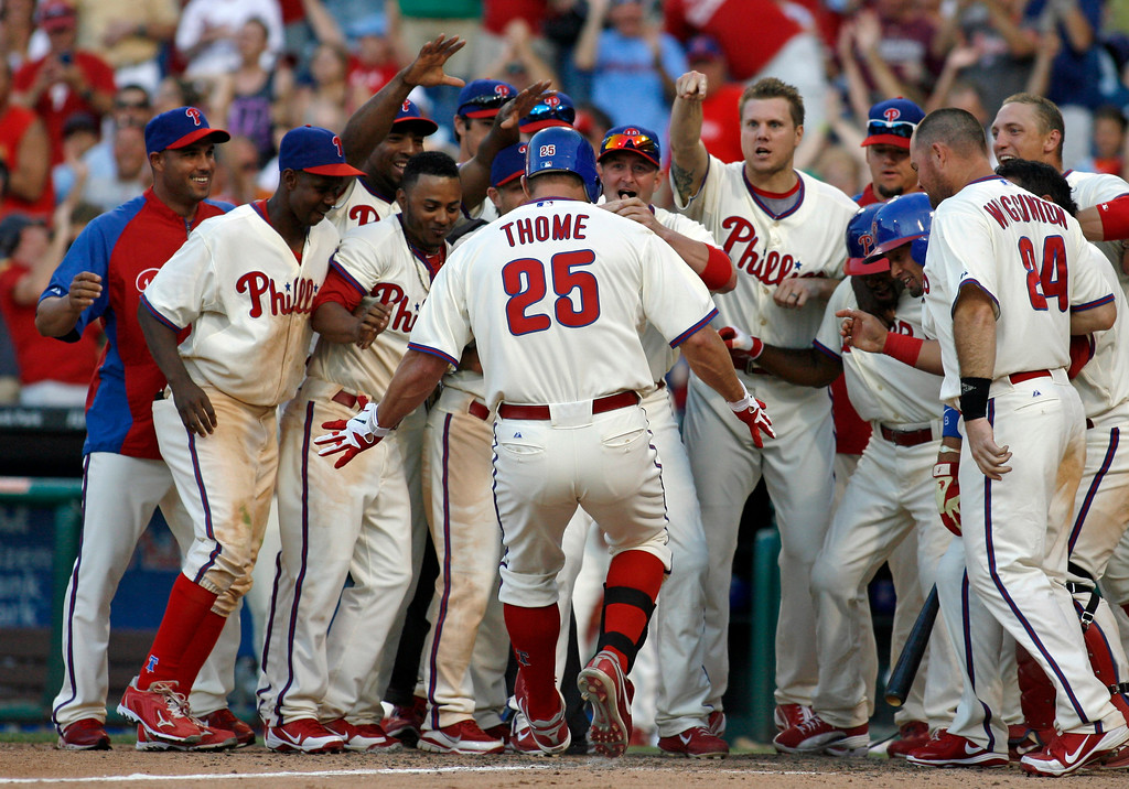 . Philadelphia Phillies\' Jim Thome (25) celebrates with his teammates after he hit a solo home run against the Tampa Bay Rays in the ninth inning of an interleague baseball game Saturday, June 23, 2012, in Philadelphia. The Phillies won 7-6. (AP Photo/H. Rumph Jr)