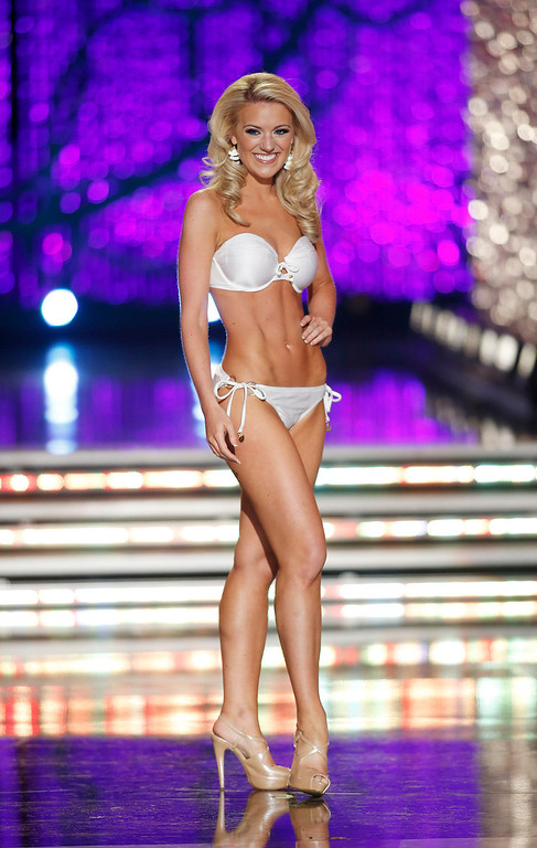 . Miss Washington Mandy Schendel competes in the swimsuit portion of the Miss America 2013 pageant on Saturday, Jan. 12, 2013, in Las Vegas. (AP Photo/Isaac Brekken)